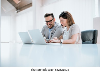 Young professionals in front of a computer