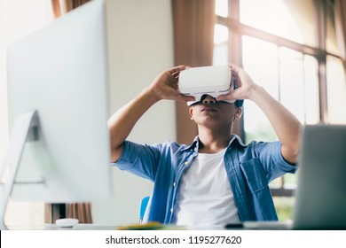 Young programmer or software developer with virtual reality glasses to testing 3D games and application. Technology and software development concept.