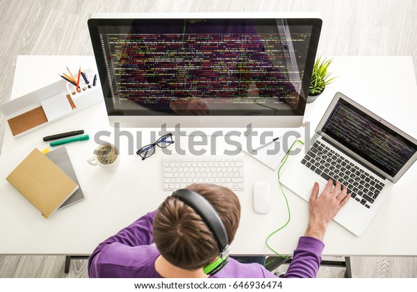 Young programmer at workplace