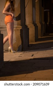 Young prostitute standing on the street