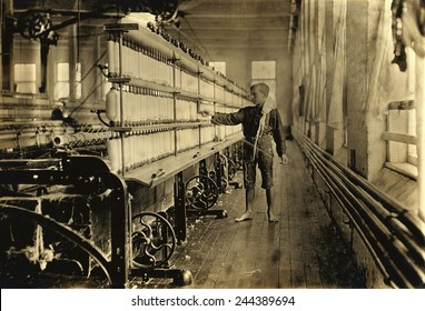 Young Raoul Julien had already worked for two years in the mule-spinning room in Chace Cotton Mill, Burlington, Vermont, when Lewis Hine took this photo in 1909.