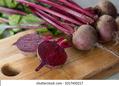Young raw red beets roots with leaves, new harvest