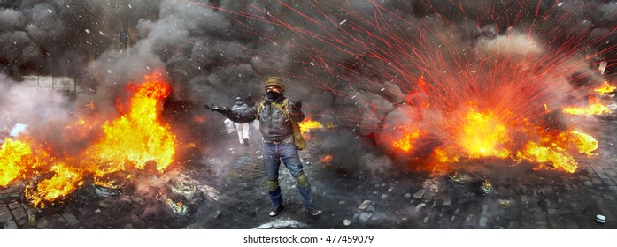 Young rebel calls for a rally... a clash of radical Protestants Maidan right sector with riot police forces of Yanukovych in the street Grushevskogo - the conflict moved to the street fighting
