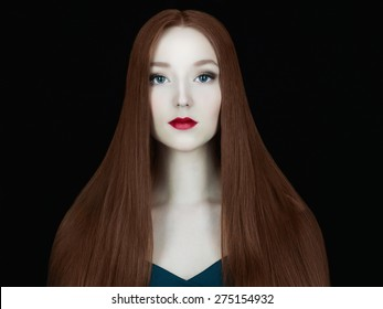 Young red hair woman.Beautiful girl model with make-up.Long healthy red hair