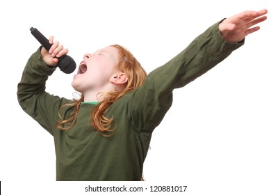 Young red haired girl singing into microphone on white background