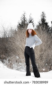 Young red headed woman in the winter.