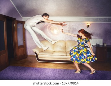 A young red-haired woman engages her super powers while getting in a fight with her man.