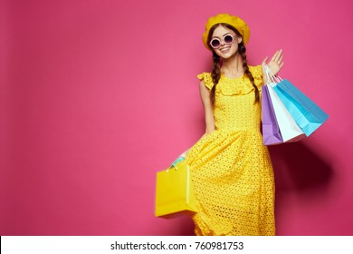 young red-haired woman with shopping, fashion