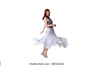 Young redhead dancing isolated on white background