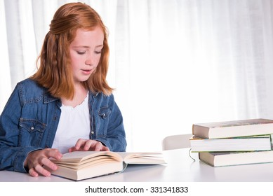 young redhead girl reading in books