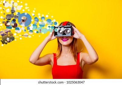 Young redhead girl with virtual reality glasses dreaming about vacation on yellow background