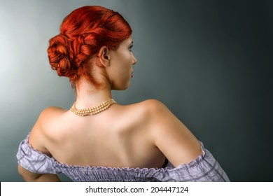 Young redhead woman with elegant hairstyle