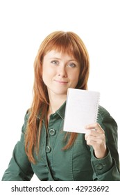 Young redhead woman showing blank notepad against white background