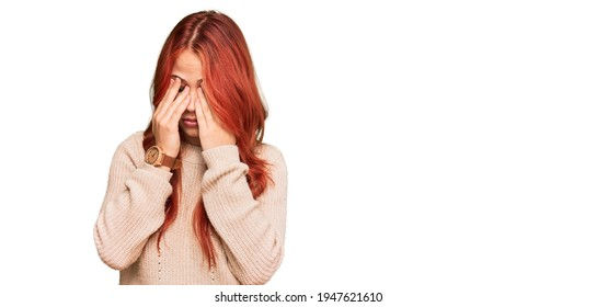 Young redhead woman wearing casual winter sweater rubbing eyes for fatigue and headache, sleepy and tired expression. vision problem