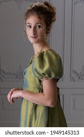 A young Regency woman wearing a silk dress shown in half view