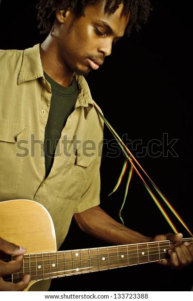 Young Reggae Musician Playing Guitar