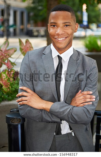 Young relaxed successful business man in the city