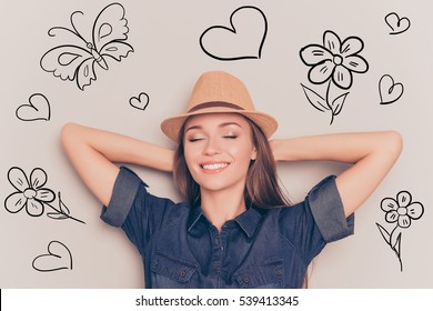 Young relaxed woman with closed eyes touching head and dreaming