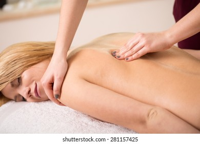 Young relaxed woman having shoulder manual therapy