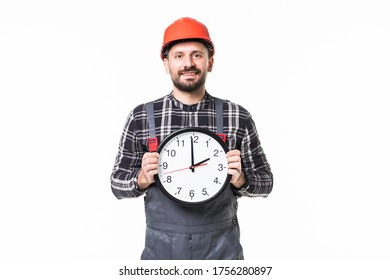 Young repairman with an alarm clock isolated on white background