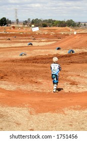 Young rider having a look at the track