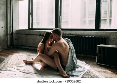 Young romantic couple in love have fun and hugs in the white bed. Love and relationships lifestyle, interior bedroom.