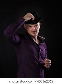 Young romantic man. Men's fashion. Man adjusts his hat.