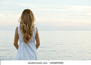 Young romantic woman with blonde curly hair on the beach, calm and relaxing concept, Bodrum, Turkey. - Shutterstock ID 1496893982