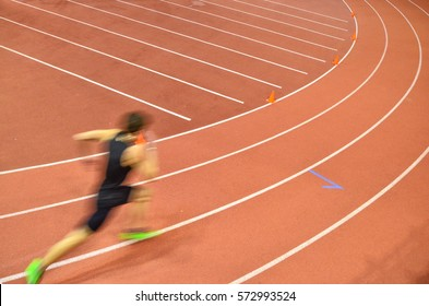Young runner - sprinters on the track of indoor athletics race
