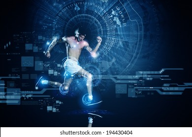 Young running man against digital media background