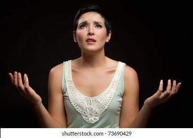 Young sad christian woman praying