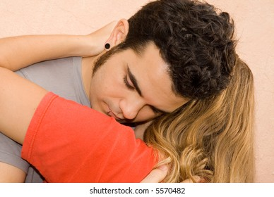young sad man being comforted by girlfriend