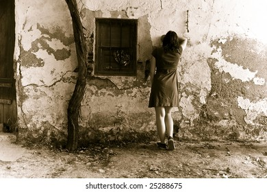Young sad woman crying in wall
