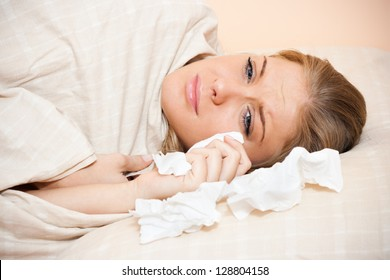 Young sad woman is lying in her bed and crying,Sad woman