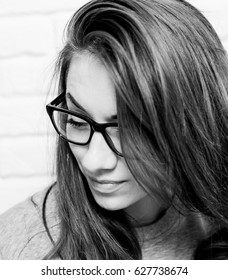young sad woman portrait in glasses