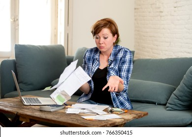 young sad worried and desperate woman banking and accounting home monthly and credit card expenses with computer laptop doing paperwork in living cost stress and paying bills problem