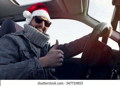 The young santa claus man show a yes sign in the car color effect