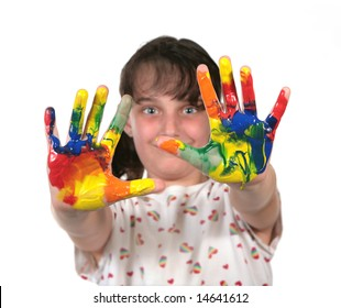 Young School Age Child With Painted Hands Ready to Make Hand Prints