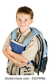 Young school boy holding a book and going to school