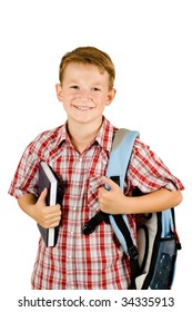 Young school boy holding a book isolated on white