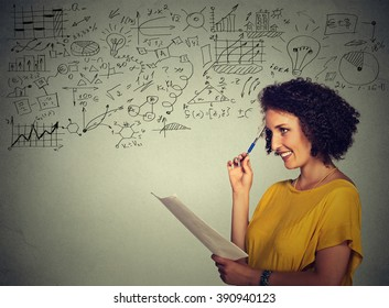 Young school college teacher standing by the chalkboard blackboard during a math science class. Positive face expression. Education concept