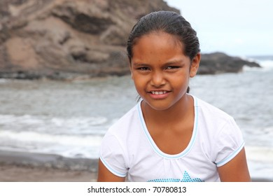 Young school girl on the beach with cute smile