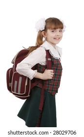 Young school girl ready for school. Little pupil is going to school. Happy young schoolgirl with satchel white background. Portrait of smiling, little girl in school uniform with backpack.