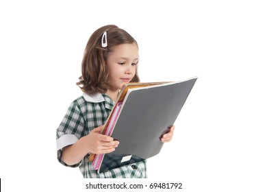 Young school girl in uniform looking at library books. Isolated on white