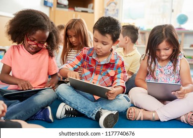Young school kids in class using tablet computers, close up