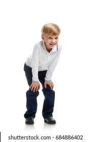 Young schoolboy crouching