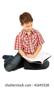 Young schoolboy reading a book, isolated on white