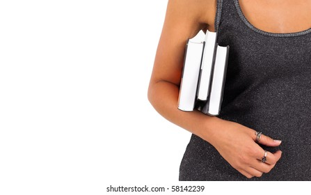 Young schoolgirl holding books