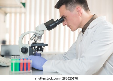young scientist working with a microscope in a laboratory