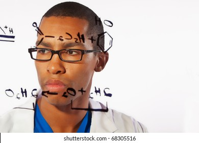 A young scientist works on a chemistry problem